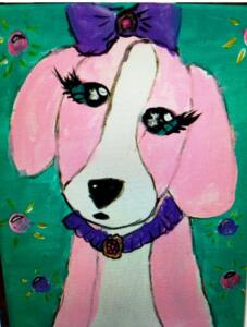 Pink dog with a bow