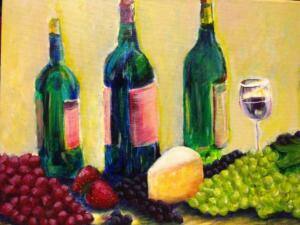 Wine bottles, grapes & cheese