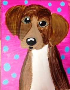 brown-dog-with-pink-polk-a-dot-background