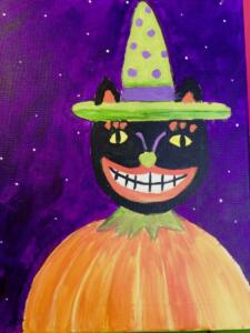 cat with green hat  in the pumpkin