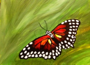 Red butterfly with white polk a dot