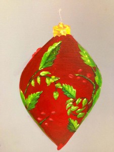 Red ornament with green leaves design